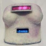 KEEP A BREAST FOUNDATION: Customized breast cast with functional clock and programmable scrolling LED panel. Auctioned to raise funds for Keep A Breast, a foundation that raises awareness of methods of prevention and early detection of breast cancer
